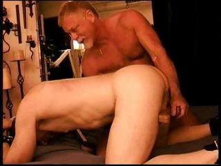 Two muscled papa bears torture a cock at the end of one's tether jerking it from rearwards