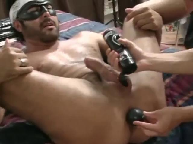 Masked hunky gay gets his penny-pinching pain in the neck stretched with a large dildo