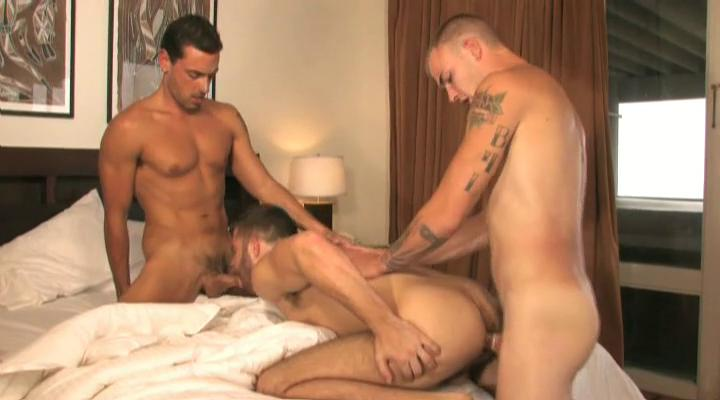 Three tanned and tattooed well-pleased studs having threesome in the house
