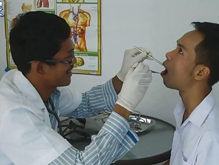 Horny Gay Doctor Gives An Oral Examination