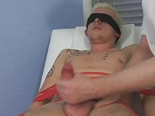 Tied and blindfolded blonde twink gets his cock sucked by mature gay daddy
