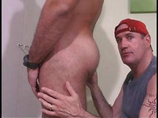 Dude in red hat sucks his cock and then licks his ass in gay duo