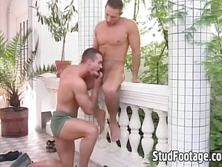 Hot gay guys making out on the balcony